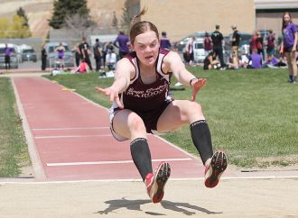 Rachael McGree defends state long jump title