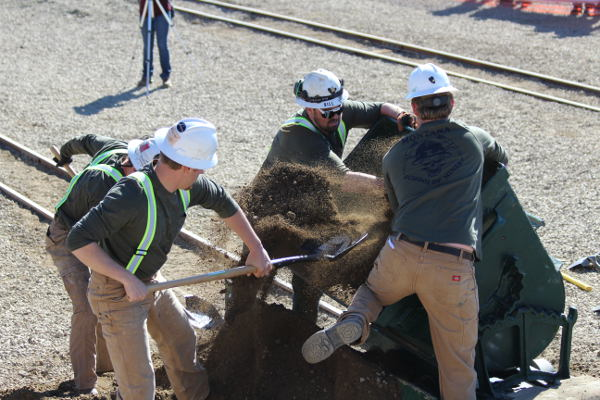 The Montana Tech Green team loads muck into the ore car in the mucking competition Saturday. (Pat Ryan photo)