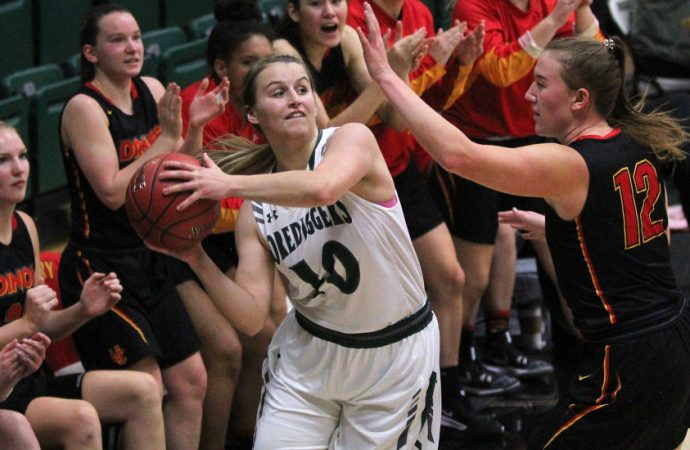 Dinos hold off Tech women