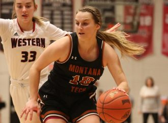 Holmes, Western women hold off Orediggers