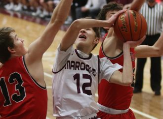 Fourth quarter lifts Maroons past Wolves