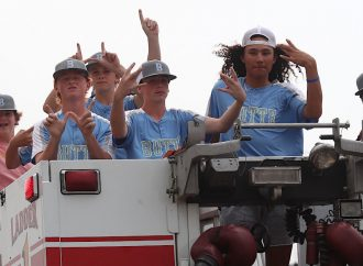 State champs hop firetruck for victory lap